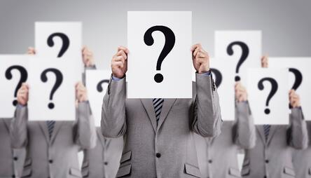 Business-colleagues-holding-question-mark-signs-000069482533_Large.jpg