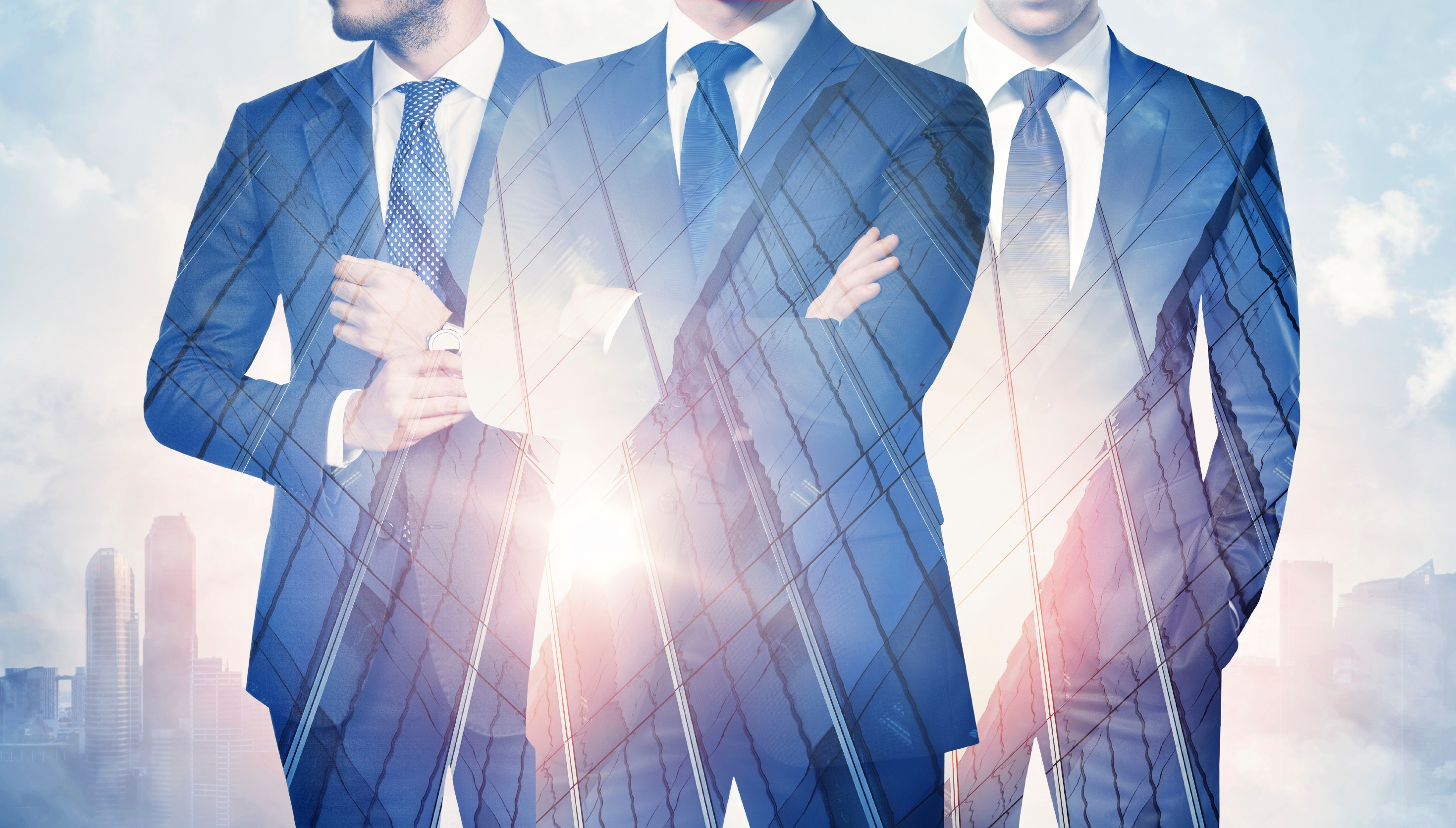 Double-exposure-of-businessmen-and-skyscraper-on-megalopolis-background-000057535954_Large.jpg