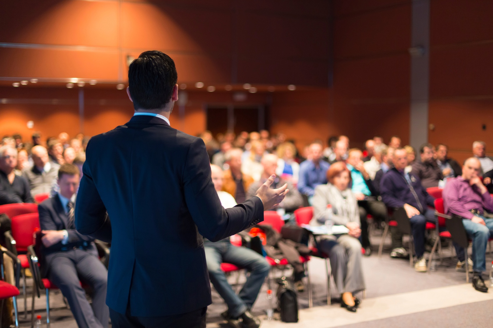 A-man-speaking-at-a-business-conference-000040536788_Medium.jpg