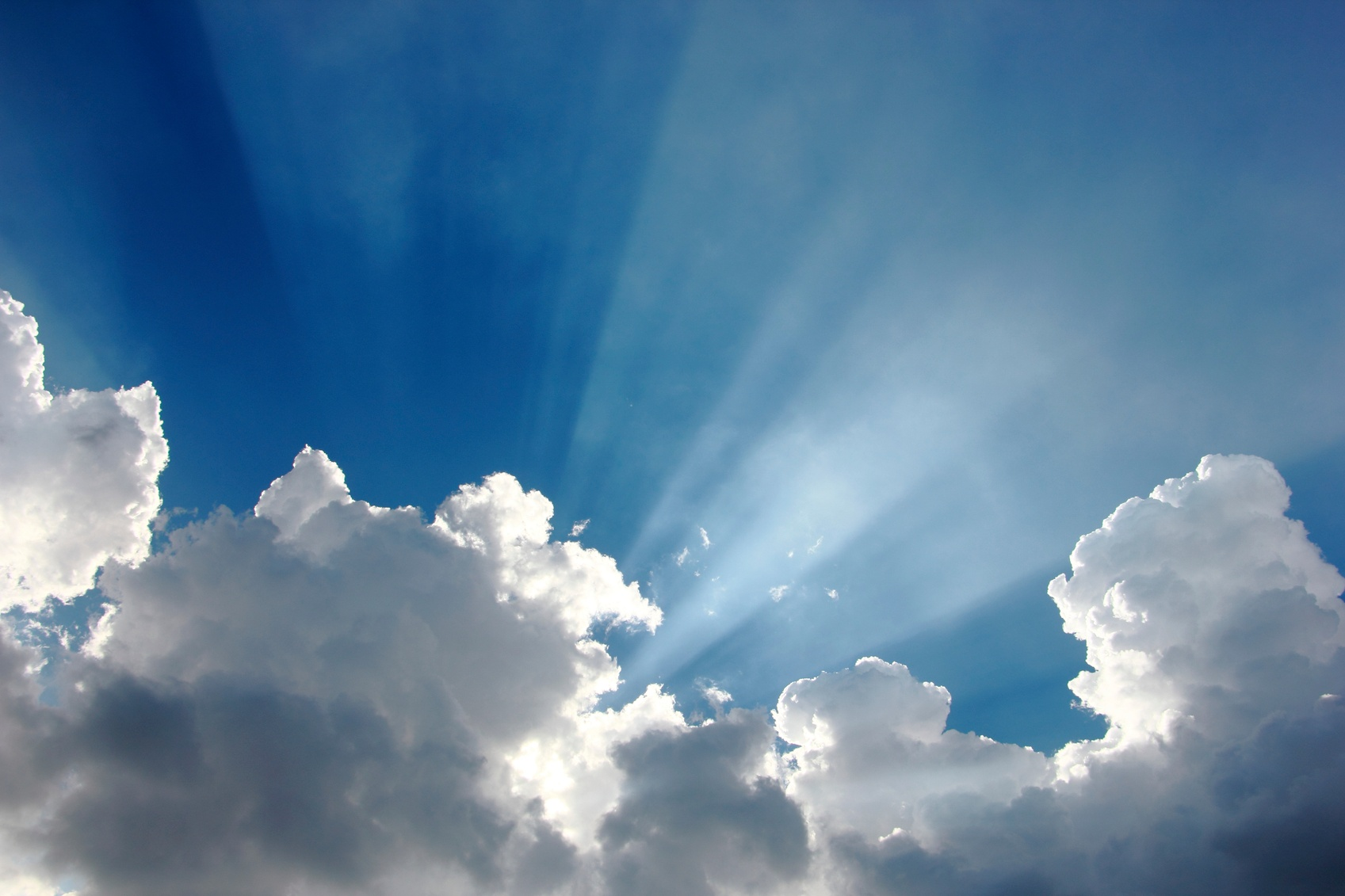 Blue-sky-with-clouds-and-sun-000080464611_Medium.jpg
