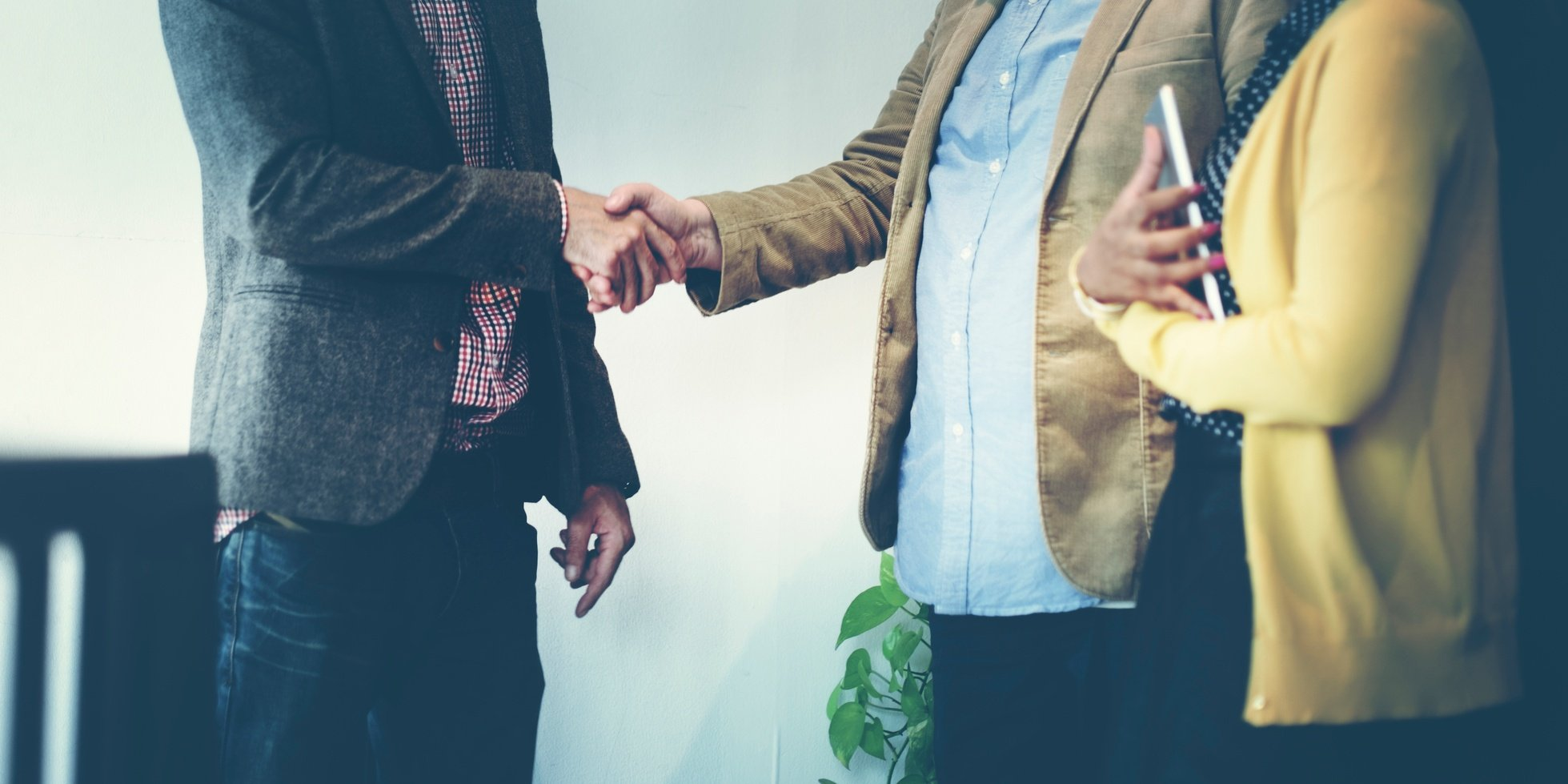 Business-Team-Partnership-Greeting-Handshake-Concept-000080824521_Medium.jpg