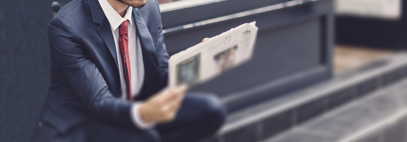 Businessman-reading-a-newspaper-000070585809_Large_cropped_again.png