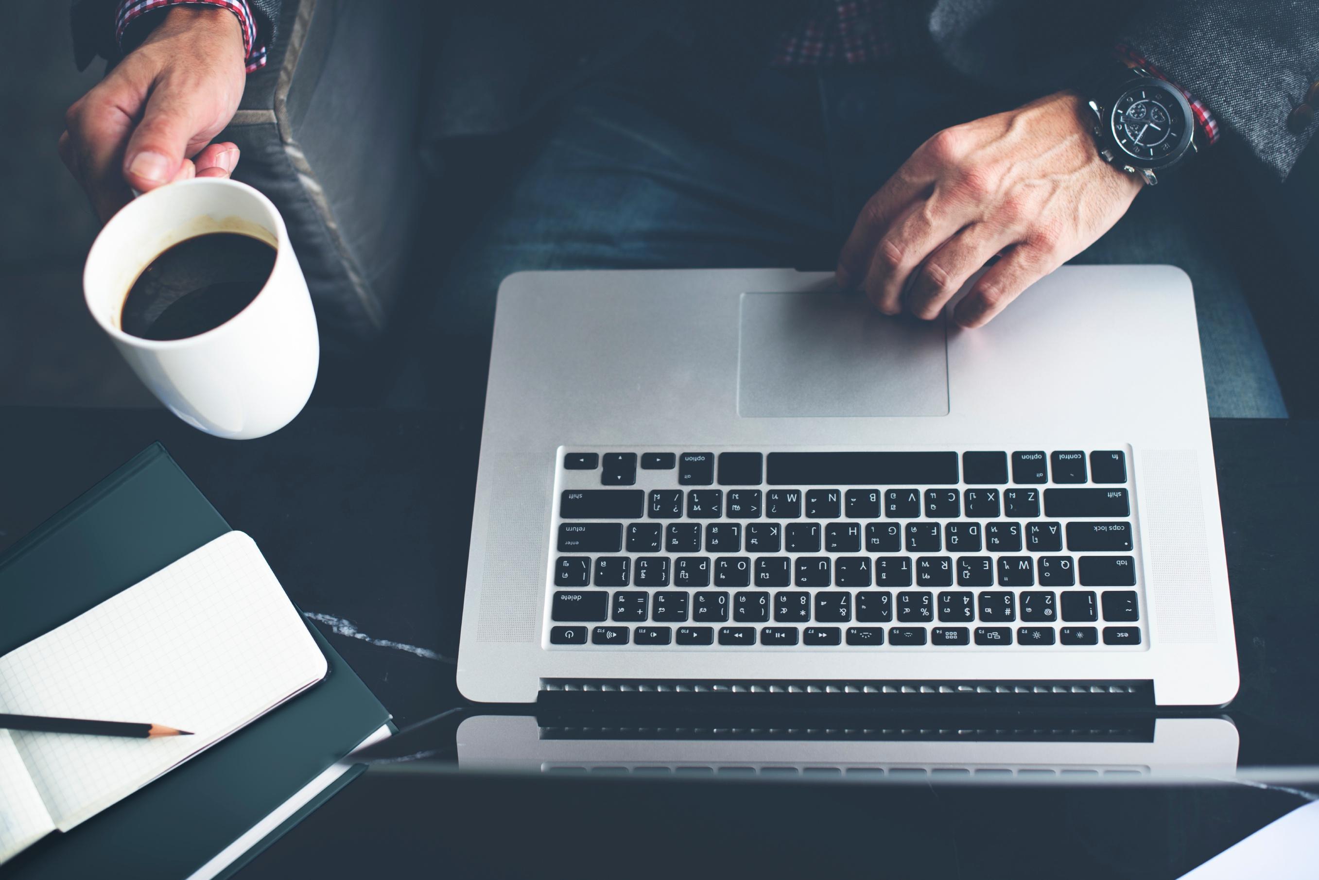 Man-Computer-Laptop-Coffee-Cafe-Concept-000079551979_Large.jpg