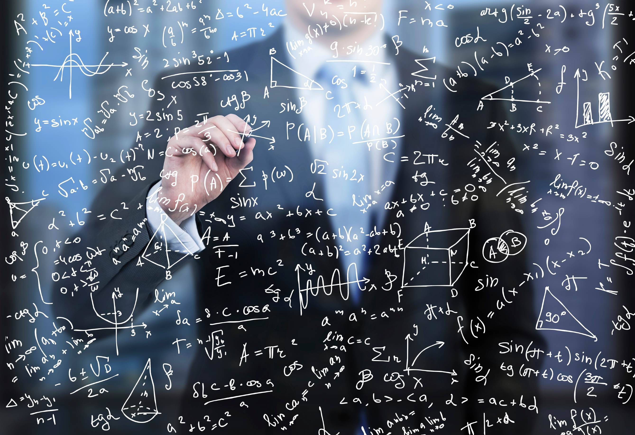 business-person-is-writing-down-math-formulas-000079366079_Large.jpg