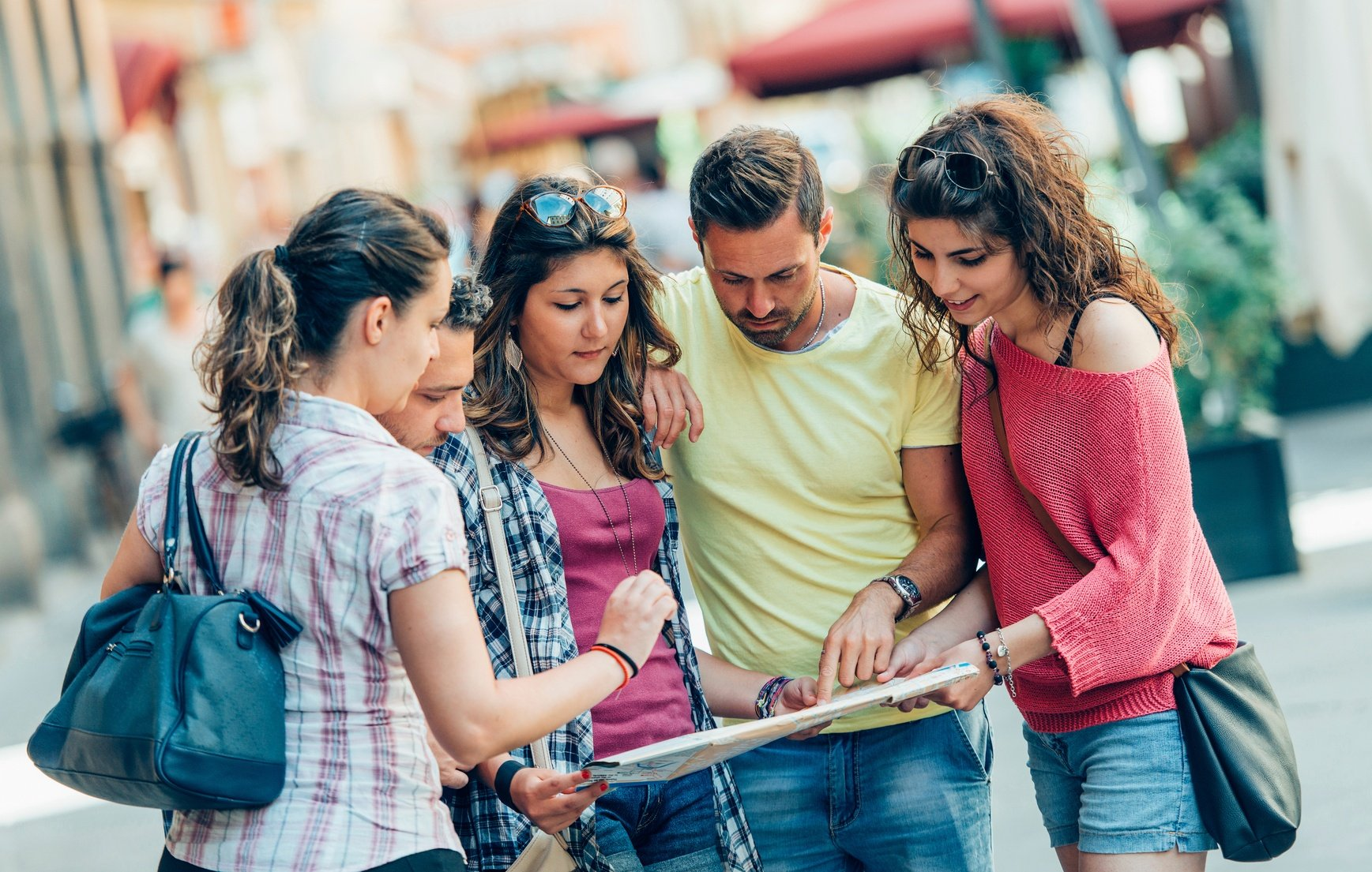 group-of-tourists-using-map-in-the-city-000092262985_Medium.jpg
